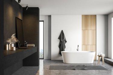 Modernes Bad in Schwarz- und Weißtönen mit Waschbecken und Wanne